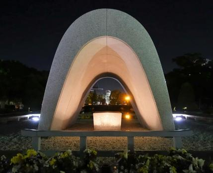 Cenotaph for the A-bomb Victimes with the flame of peace in the back