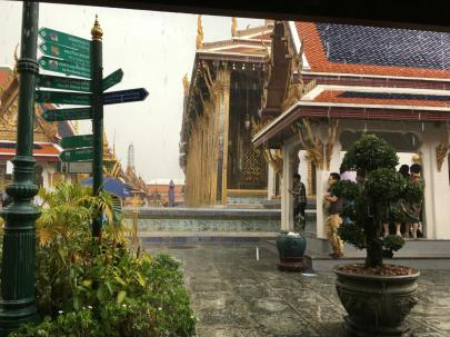 Temple of the Emerald Buddha under rain